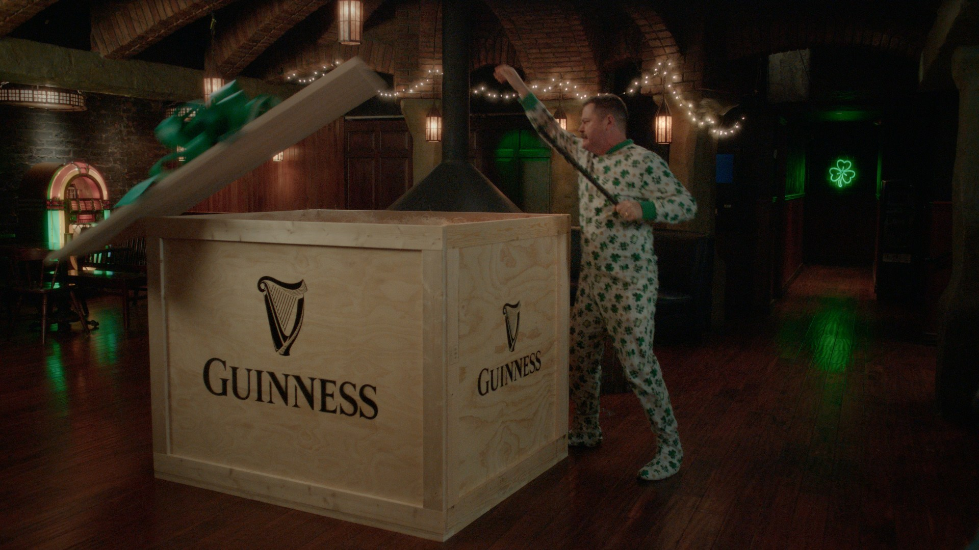 Nick Offerman opening a crate marked Guinness
